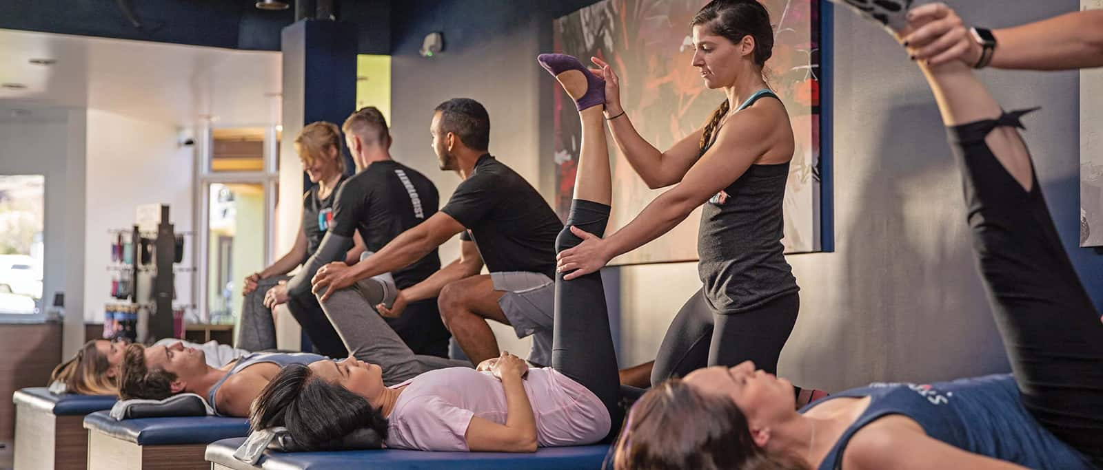 Women and men getting stretch by professionals at Stretch Lab in El Segundo
